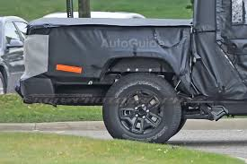 jeep truck spy photos spy photos reveal more about jeep wrangler pickup autoguide com news