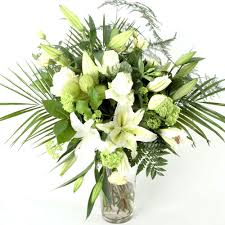 bouquet of lilies white flower bouquet containing lilies with complimenting flowers