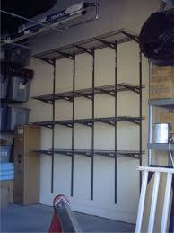 warm wooden shelves rustic brick wall spacious garage storage image of design garage shelving ideas