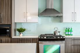 kitchens with glass tile backsplash subway glass tile backsplash kitchen modern with counter stools