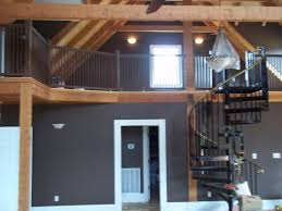 Cabin Interior Great Room View Of Loft Wall Color Leather Chair - Interior paint colors for log homes