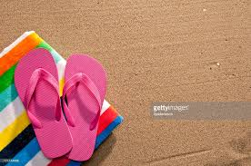 flip flop towel flip flops and towel on sand stock photo getty images
