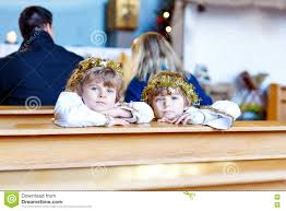 two little boys playing an angel of christmas story in church
