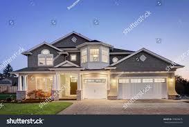 luxury home exterior twilight stock photo 159028475 shutterstock