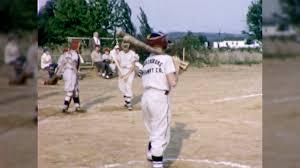 boy swings bat home plate baseball game kids 60s vintage film home