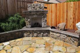 modern natural design of the garden wall fireplace outside that
