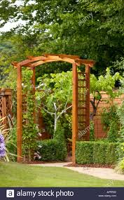 tatton flower show wooden pergola in garden with fruit trees to