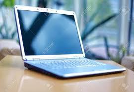 Office Desk Close Up Thin Laptop On Office Desk Stock Photo Picture And Royalty Free
