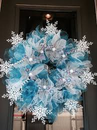Decorating A Christmas Wreath With Mesh Ribbon by Deco Mesh Christmas Wreaths Blue White Snowflakes Christmas Home