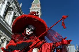 venetian carnival costumes venice carnival revellers don elaborate masks and costumes photo