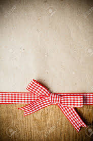 checkered ribbon wooden background with a checkered ribbon and bow on brown