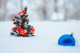 Blue Christmas Trees Decorating Ideas - christmas tree decorations and gift on snow against blue