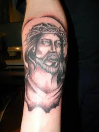 black and grey jesus face tattoo design for arm by craig wright