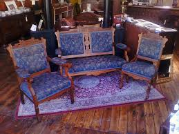 three piece victorian parlor set with settee gentleman s chair and las chair nice set with walnut woodwork and incised trim
