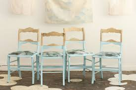 beautifully dipped bare wood kitchen chairs in baby blue artenzo