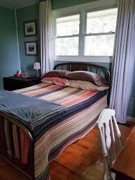 refinishing a vintage metal bed frame home on 129 acres