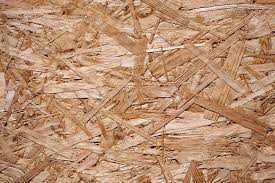 recycled wood up of a recycled compressed wood chippings board stock photo