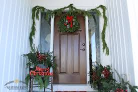 front porch decorating with porch pots and fresh garland