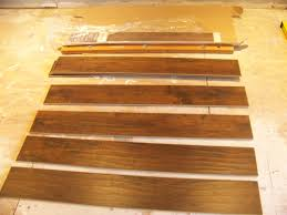 Putting Laminate Flooring On Stairs Installing Laminate Flooring Diy Bonus Room Makeover