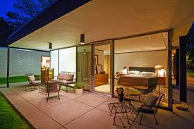 photo 9 of 10 in a renovated midcentury glass and steel house in