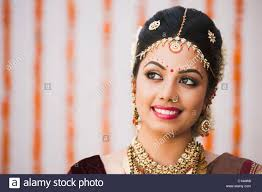traditional dress up of indian weddings up of a smiling in traditional south indian dress