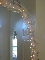 wedding arches using tulle decorating with white lights and tulle lighting decor