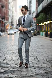 light gray suit brown shoes man of few words tommy hilfiger galla