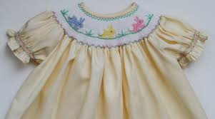 hand smocked yellow girls bishop dress with the easter bunny