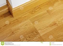 Fitting Laminate Flooring Under Skirting Boards Laminate Wooden Flooring And Skirting Boards Royalty Free Stock