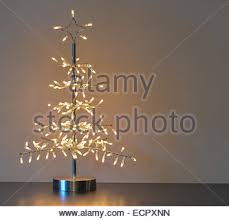 Metal Christmas Light Decorations by Silver Metal Christmas Tree Decoration Standing On Table With Warm