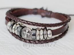 woven bracelet with cross images By ordering from our shop you agree that you have read and jpg