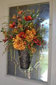 flower arrangement hung on the outside of the front door