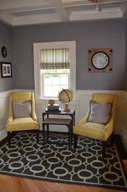 jessica stout design office gray yellow custom upholstered chairs custom made roman shades and the high end light fixture are something that will last throughout the years and make a huge impact