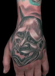 hand devil tattoo by bloody blue tattoo