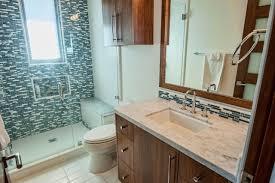 bathroom walk in shower with glass door and marble wall bathroom