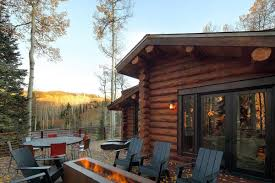 outdoor contemporary fireplace modern log cabin in telluride