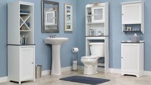 bathroom over the toilet linen storage shelf that goes over