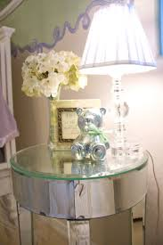 saving small teenage bedroom spaces with narrow glass top round