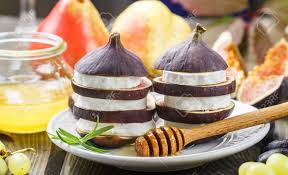 gourmet pears appetizer of figs and goat cheese with honey layered salad of