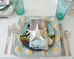 beachy centerpieces themed table setting tablescape with lighthouse lantern and