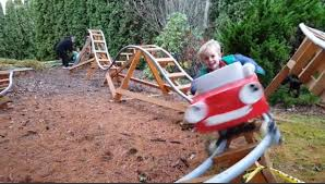roller coaster for backyard dad builds backyard roller coaster for kids wins dad of the year