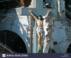 jesus on the cross in front of the collapsed sacre coeur church in