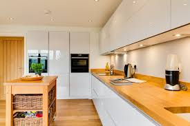 solid wood kitchen cabinets ireland nobilia white high gloss kitchen with solid wood worktop