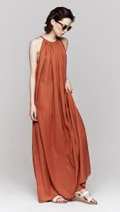 heidi merrick grecian dress in sienna features a dark orange long