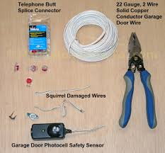 Replacing A Garage Door How To Repair Garage Door Safety Sensor Wires