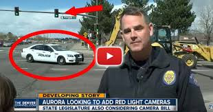 ran a red light camera video while officer says running red lights is illegal behind him