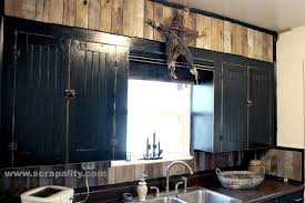 How To Paint Kitchen Cabinets Black Black Chalkboard Cabinets With Pallet Backsplash Hometalk