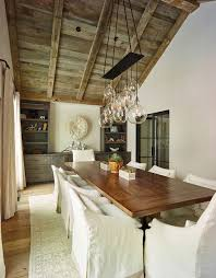 california dreamin e2 interior design appointed the dining room with a white feathered african juju headdress and