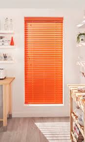 bring colour into your kitchen with bright coloured wooden blinds