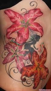 lily tattoo on rib tattoo viewer com